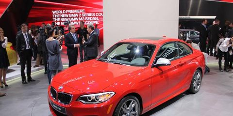 The BMW M235i on the Detroit auto show stand.