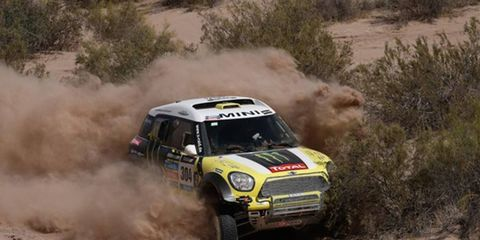 Nani Roma (pictured) took over the lead at the Dakar Rally. Following the day's activity, two members of a news team died when when their car plunged off a cliff.