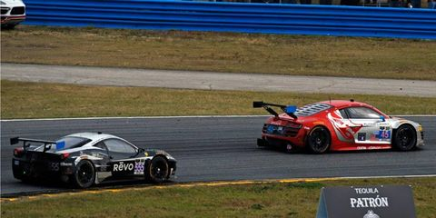 The Flying Lizard Audi R8 LMS battles Level 5 Motorsports Ferrari 458 Italia (555) in a battle that would eventually be decided by IMSA's race director at the Rolex 24 at Daytona on Sunday.