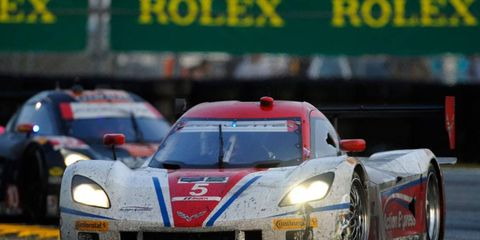 Joao Barbosa, Christian Fittipaldi, Sebastien Bourdais and Burt Frisselle combined to bring the No. 5 Chevrolet Corvette DP to the top of the podium at the Rolex 24 on Sunday.