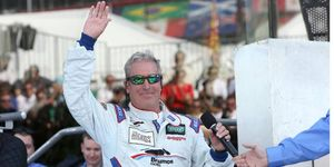Hurley Haywood waves to the crowd at the 2013 Rolex 24 Hours at Daytona.
