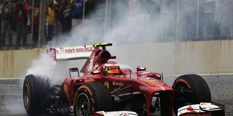 Felipe Massa celebrates a victory in the Ferrari F138 last season. The new F14 T will see the track in 2014.