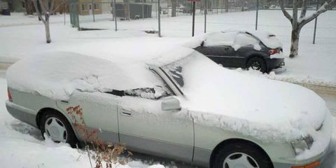 There's a 50/50 chance this guy would brush the snow off his car before heading to work.