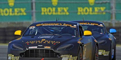 The No.7 and No. 9 Aston Martin Vantage race cars in action at Daytona.