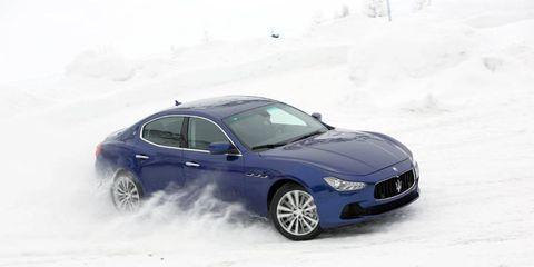 A Maserati slides sideways through the snow.