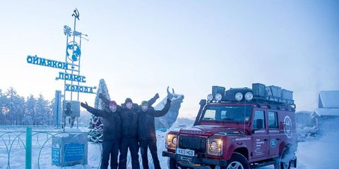 The team celebrates at the entry to Oymyakon, in Russia's far east.