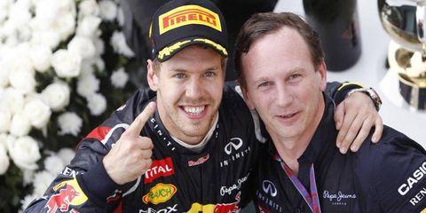 Christian Horner (right) and Sebastian Vettel celebrate during Vettel's 2013 championship run.
