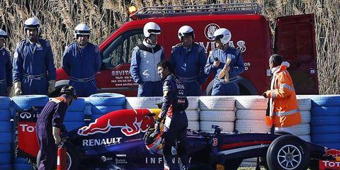 Daniel Ricciardo looks over his car, the new RB10 Renault.