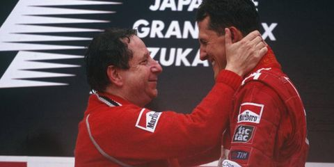 Jean Todt (left) and Michael Schumacher stand on the podium after Schumacher won the 2000 Japanese Grand Prix.