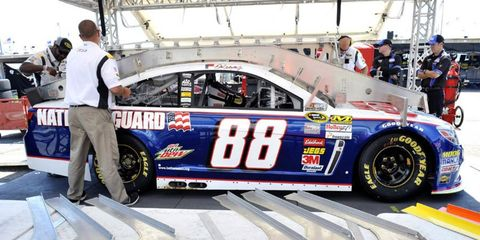 Dale Earnhard Jr's car goes through inspection in Dover last year. This week, NASCAR announced a new penalty structure.
