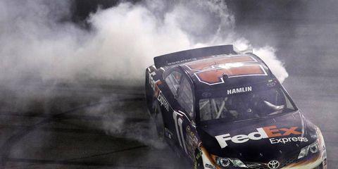 Denny Hamlin burns his tires after winning the Sprint Unlimited on Saturday night in Daytona.