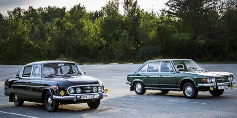 """A 1969 Tatra T603 poses next to a T613 """"Chromka"""" from 1978, both of which reside in the same collection."""