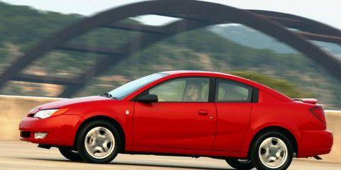 Tire, Wheel, Vehicle, Automotive mirror, Automotive design, Car, Red, Vehicle door, Full-size car, Mid-size car,