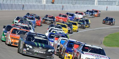 Brad Keseslowski (22) gets the jump on Kyle Busch on his way the NASCAR Nationwide Series win at Las Vegas on Saturday.