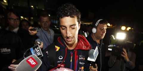 Daniel Ricciardo answers questions after it was ruled that he would be disqualified from the results of the Australian GP.