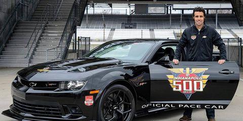 Dario Franchitti poses alongside the 2014 Chevrolet Camaro Z/28 pace car he'll be driving.