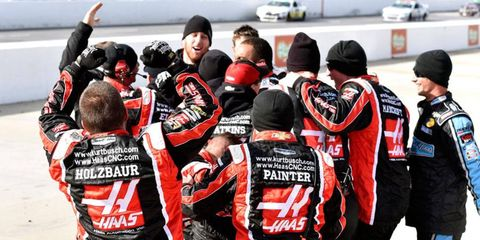 Kurt Busch is mobbed by his Stewart-Haas Racing teammates after the win at Martinsville on Sunday.