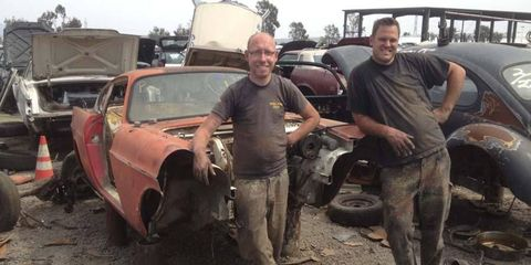 Taking a break from dismembering a Volvo P1800.