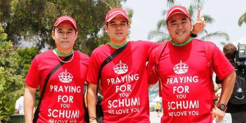 Michael Schumacher fans show their support on Sunday in Bahrain.