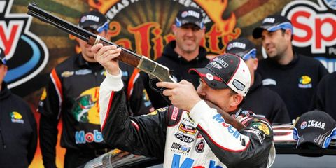 Tony Stewart celebrates his first pole in the NASCAR Sprint Cup Series since 2012 at Atlanta.