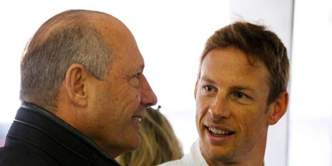 McLaren boss Ron Dennis, left, has his lawyers working to stop Dan Fallows from workiong at Red Bull Racing. McLaren driver Jenson Button is pictured at right.