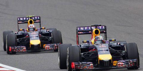 Sebastian Vettel leads teammate Daniel Ricciardo at the Formula One Chinese Grand Prix. The lead was short-lived, however.