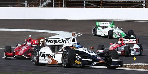 Indy cars go through their paces on the road course at the Indianapolis Motor Speedway on Wednesday.
