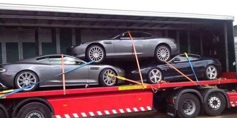 This is probably the least appealing way to get an Aston Martin from point A to point B.