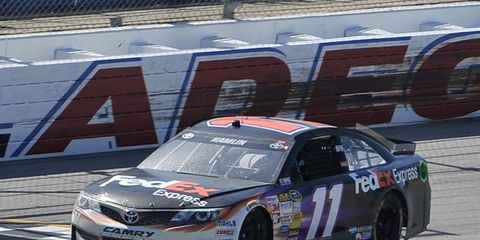 Denny Hamlin virtually clinched his spot in the NASCAR Chase with his first win of the season on Sunday at Talladega Superspeedway.