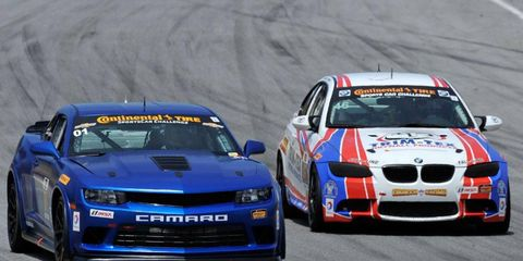 BMW, right, kicked off the weekend at Mazda Laguna Raceway with a charge and a win in the Continental Tire SportsCar Challenge on Saturday.