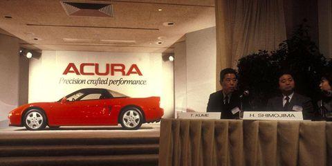Tadashi Kume, president of Honda, next to Hiroyuki Shimojima, head of Honda R&D.