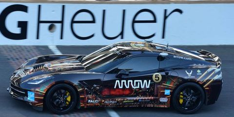 Sam Schmidt, paralyzed in a racing crash in 2000, was back on the bricks of the Indianapolis Motor Speedway on Sunday.