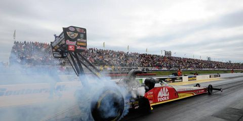 Doug Kalitta held the top qualifying position in Top Fuel for the NHRA eliminations that were rained out on Sunday at Atlanta Dragway.