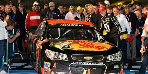 Jamie McMurray makes his way to victory lane at Charlotte Motor Speedway on Saturday night.