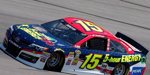 Clint Bowyer won the Sprint Showdown at Charlotte Motor Speedway on Friday night to earn his way into the Sprint All-Star Race on Saturday night.