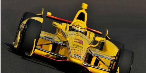 Helio Castroneves established himself as a favorite for the pole at Indianapolis with a speed of 227.166 mph in practice on Thursday.