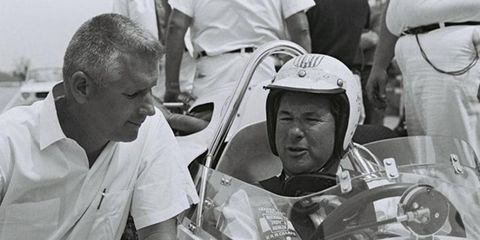 A.J. Watson, left, built six Indianapolis 500-winning cars in his career. At right is Rodger Ward, who won two 500s with Watson.  He's in the 1964 Watson rear-engine design.