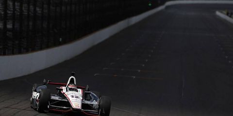 IndyCar driver Will Power takes laps at the oval at Indianapolis Motor Speedway.