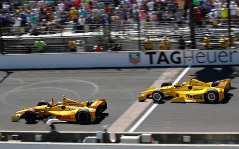 ryan hunter reay barely beats helio castroneves across the finish line a thrilling conclusion to the 98th indy 500