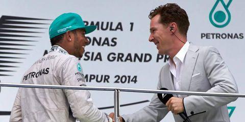 Benedict Cumberbatch congratulates Lewis Hamilton after the Malaysia Grand Prix.