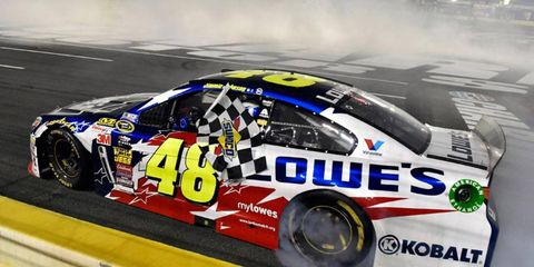 Jimmie Johnson held off Kevin Harvick and Matt Kenseth over the final few laps to win at Charlotte Motor Speedway.