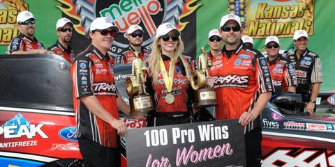 Courtney Force celebrates win No. 100 with her John Force Racing teammates on Sunday.