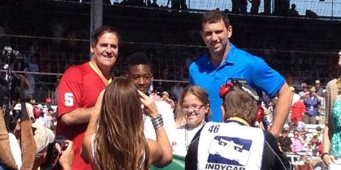 Mark Cuban, standing next to Indianapolis Colts quarterback, Andrew Luck, will act as the Honorary Starter at the Indy 500.