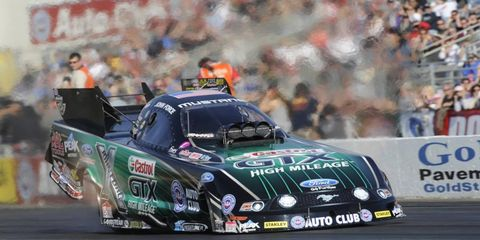 John Force is a 16-time and defending Funny Car season champion.
