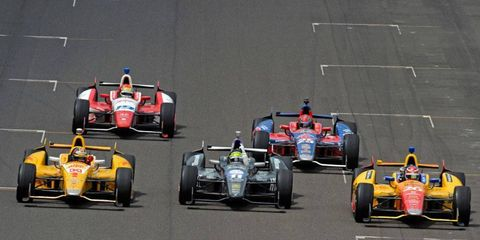 Tony Kanaan, in the center car, on his way to claiming victory in the 2013 Indy 500.