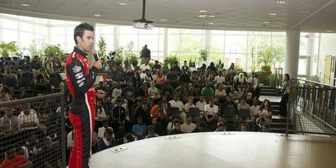 """Mazda racecar driver Joel Miller told high school students in Detroit he's a """"driver at heart"""" but said engineering allows him to share what the company learns on the track with Mazda's product engineers."""