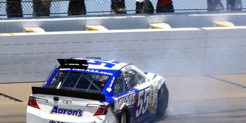 Brian Vickers spins out on the first lap of Sunday's NASCAR Sprint Cup Series race at Michigan International Speedway on Sunday.