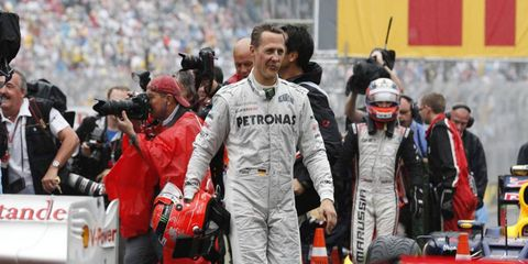 According to his management team, Michael Schumacher has awoken from his coma.
