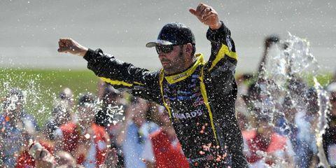 Paul Menard took advantage of Joey Logano's flat tire to pick up a win at Michigan.