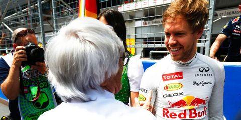 Sebastian Vettel, right, needs to be in a fast car, says Bernie Ecclestone, left.